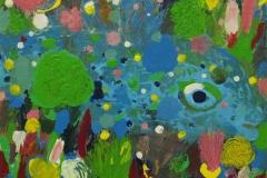 Kleiner blauer Fisch im Korallenriff